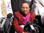Nguyen Thi Hong speaks to throngs of reporters outside court