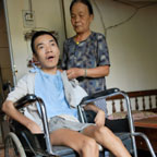 70-year old mother caring for 30-year old son disabled by Agent Orange
